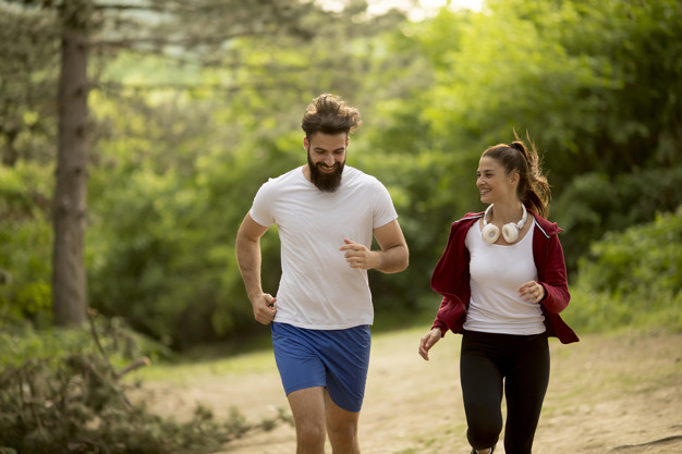 Couple jogging outdoors in nature